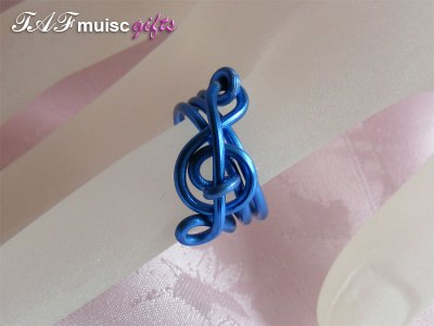 Blue treble clef music themed statement ring
