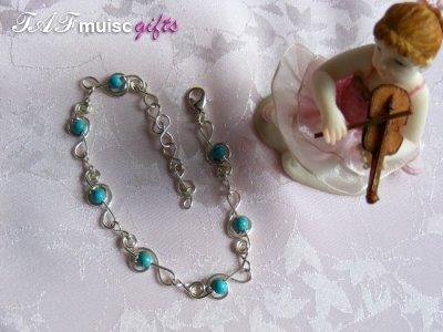 Blue turquoise treble clef music themed bracelet