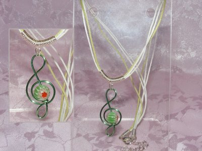 Green lampwork glass handmade treble clef necklace