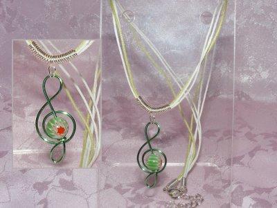Green lampwork glass handmade treble clef necklace