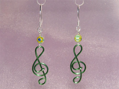 Green lampwork glass music themed earrings