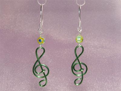Green lampwork glass music themed earrings