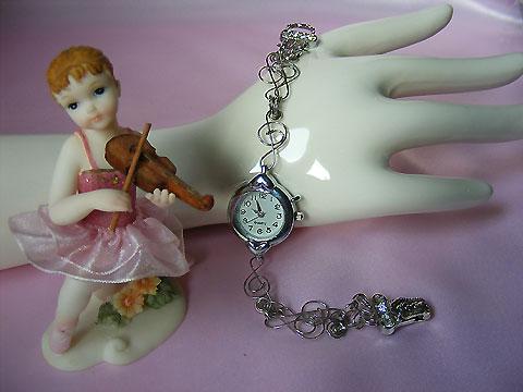 Music themed silver tone bracelet watch