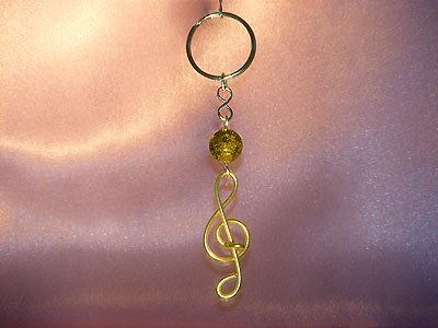 Music themed yellow treble clef key ring