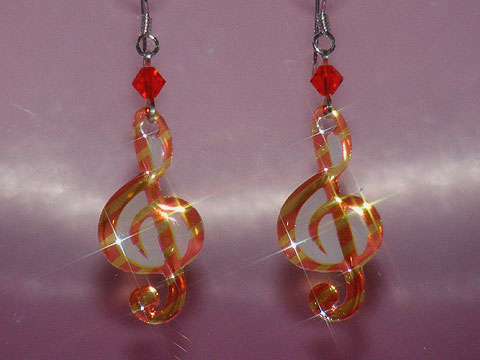 Orange treble clef music note earrings