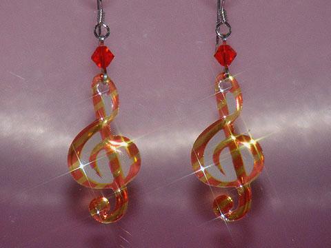 Orange treble clef music note earrings
