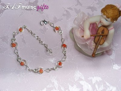 Orange glass bead treble clef music themed bracelet