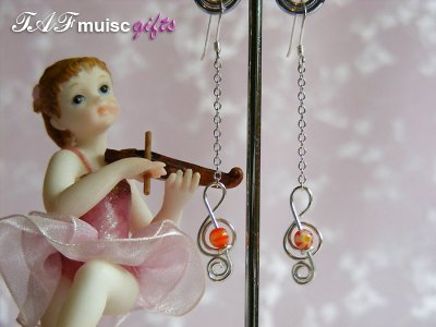 Orange glass bead treble clef music themed earrings