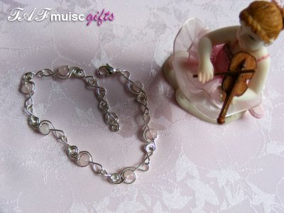 Pink rose quartz treble clef music themed bracelet