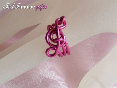 Pink treble clef music themed statement ring