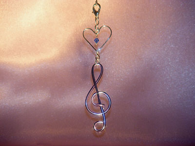 Purple treble clef music themed decoration