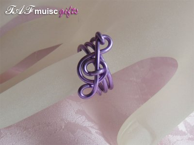 Purple treble clef music themed statement ring