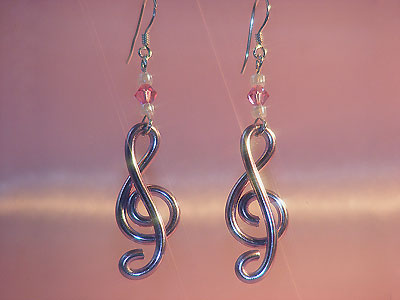 Rose pink treble clef music note earrings