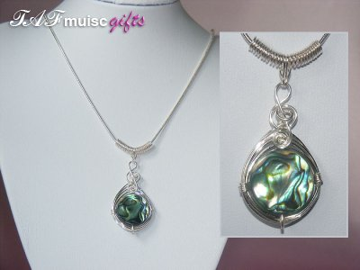 Round abalone shell music themed necklace