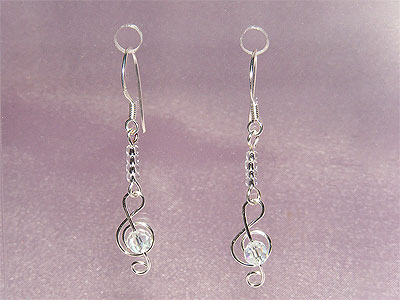 Silver treble clef music note earrings