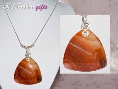 Striking orange Agate music themed necklace
